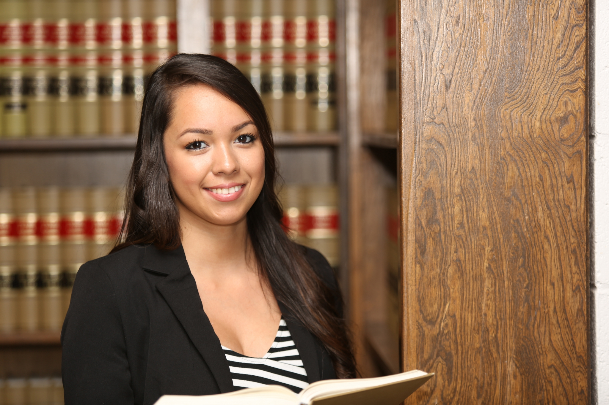 Young Female Hispanic Lawyer in Law Library